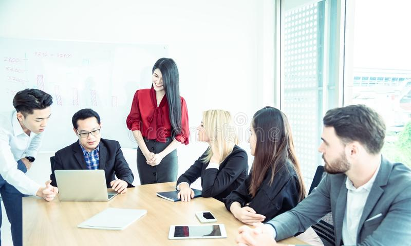 Teamwork business concept .Start up business people in modern office, working together having success. Multi ethnic start-up stock image
