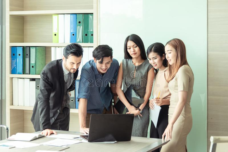 Teamwork business concept .Start up business people in modern office, working together having success. Multiethnic start-up royalty free stock images