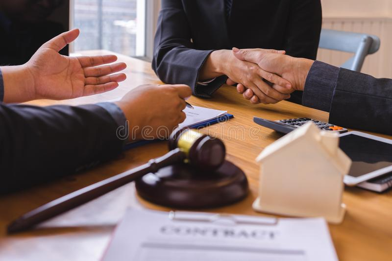 Teamwork of business legal shaking hands meeting after great meeting about Property Law. In courtroom to help their customer royalty free stock image
