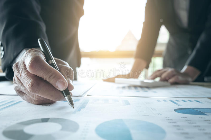 Teamwork of business two colleagues analysis with financial data. And marketing report graph, Young co worker discussing and brainstorm new idea for start up royalty free stock images