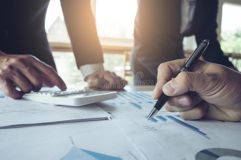 Teamwork of business two colleagues analysis with financial data. And marketing report graph, Young co worker discussing and brainstorm new idea for start up royalty free stock photo