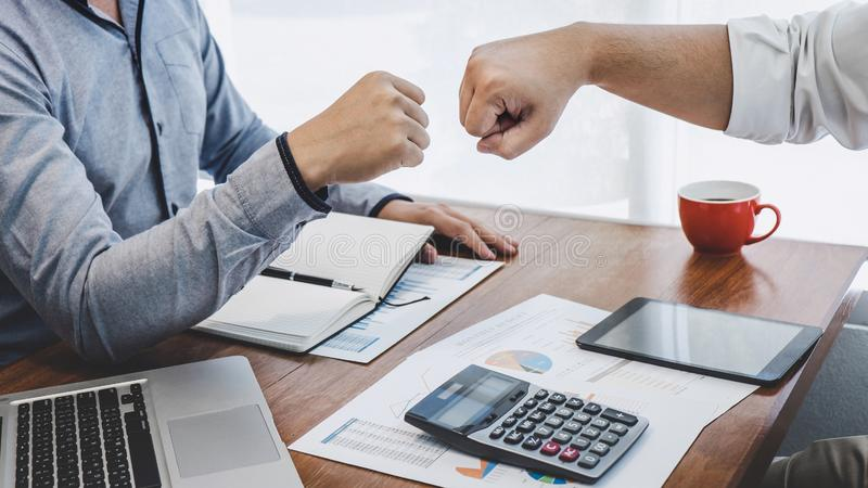 Teamwork of businesspeople partnership giving fist bump to greeting start up business strategy project.  royalty free stock photo