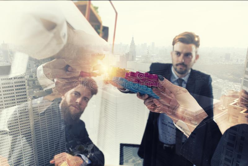Business team connect pieces of gears. Teamwork, partnership and integration concept. double exposure royalty free stock photo