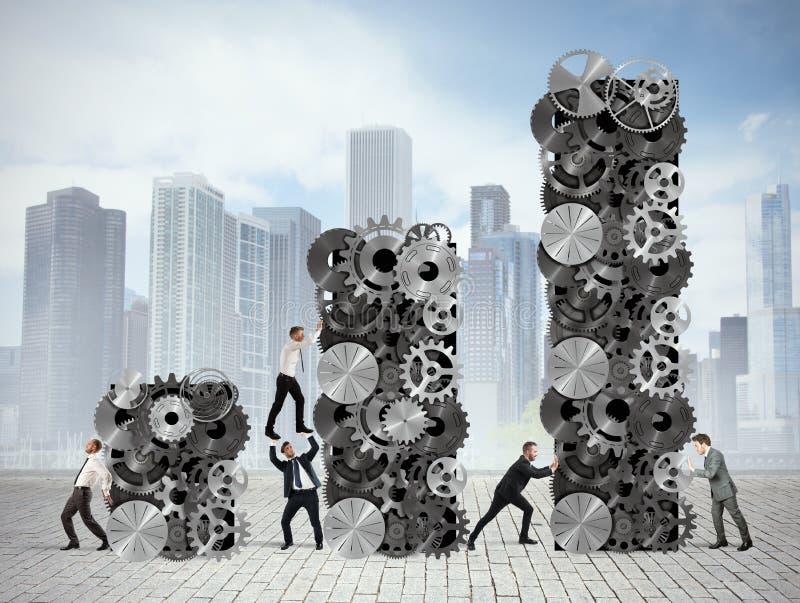 Teamwork bygger företags vinst arkivbild