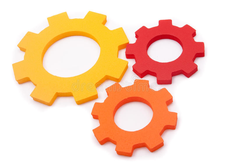 Teamwork cogs. Isolated teamwork cogs over white royalty free stock image