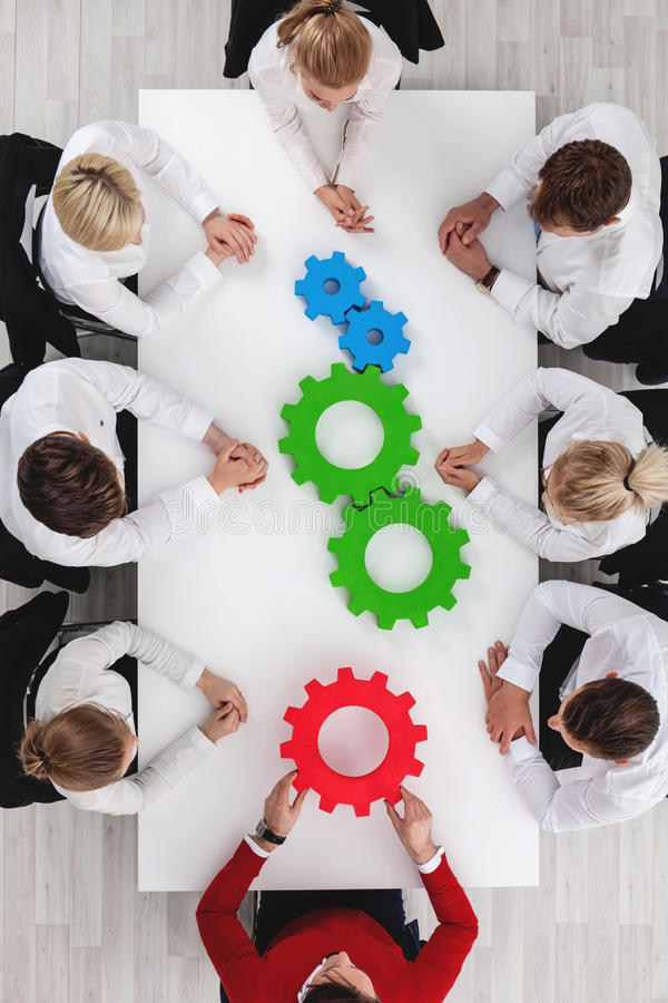 Teamwork with cogs of business stock photos