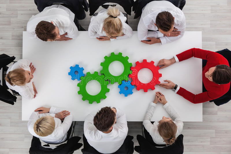 Teamwork with cogs of business royalty free stock image
