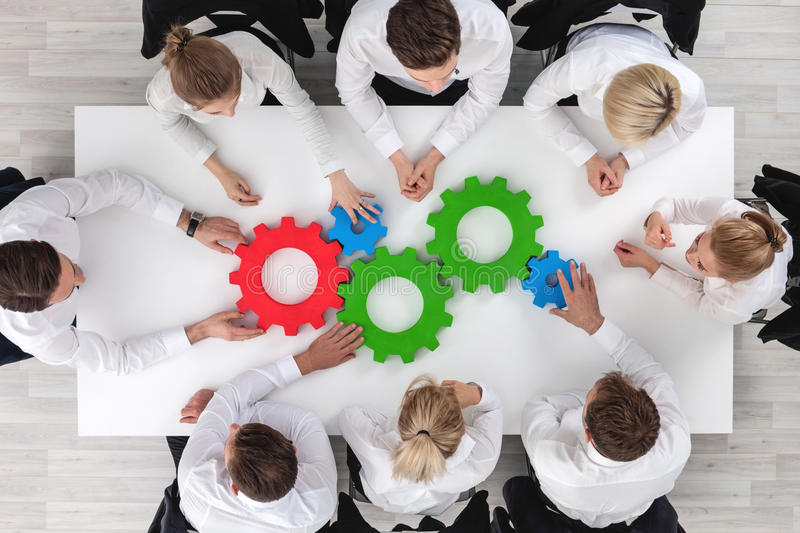 Teamwork with cogs of business stock images