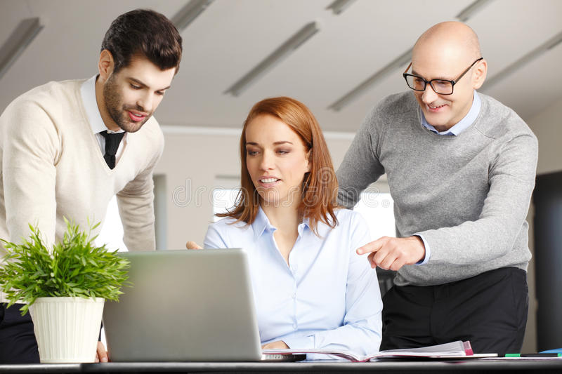 Teamwork with computer royalty free stock images