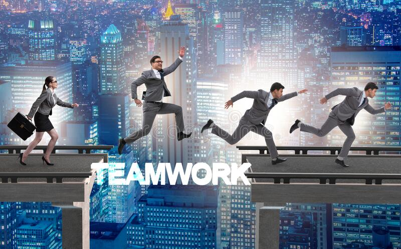 Teamwork concept with business people crossing bridge royalty free stock photos