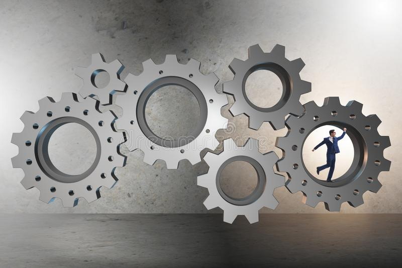 The teamwork concept with cogwheels and business people. Teamwork concept with cogwheels and business people stock images