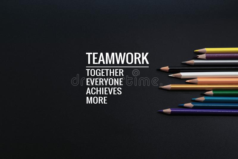 Teamwork concept. group of color pencil on black background with word Teamwork, Together, Everyone, Achieves and More stock photos