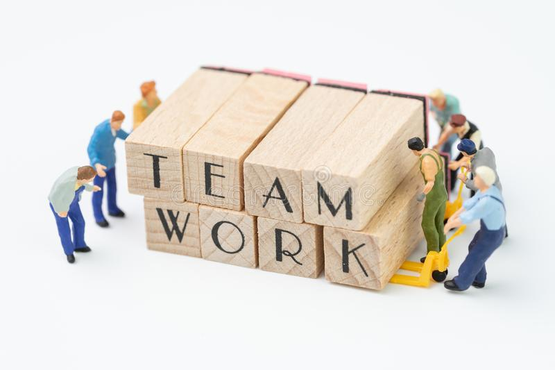 Teamwork concept idea, miniature people figurine work as team he royalty free stock photo