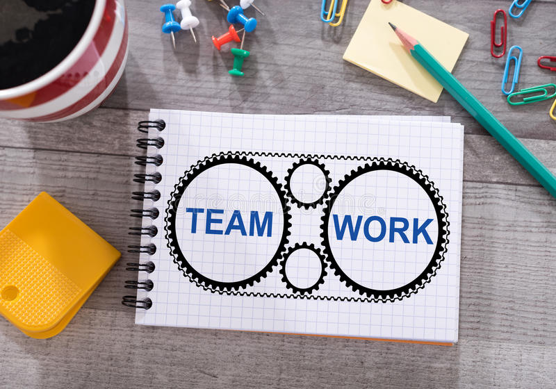 Teamwork concept on a notepad. Teamwork concept drawn on a notepad placed on a desk royalty free stock photos