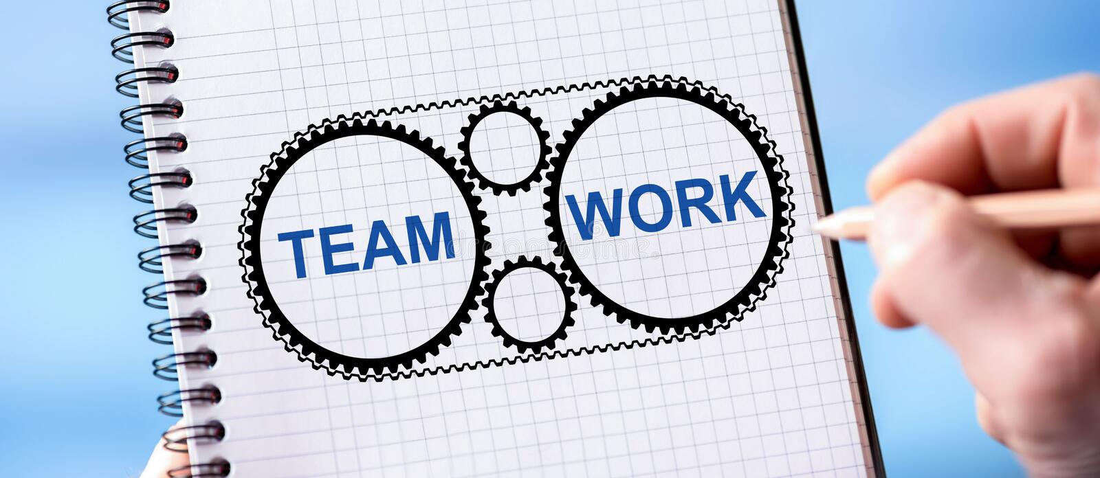 Teamwork concept on a notepad. Hand drawing teamwork concept on a notepad royalty free stock photography