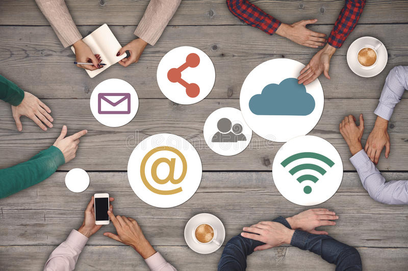 Teamwork concept - top view of six creative people working Social Media Icon Concept stock image