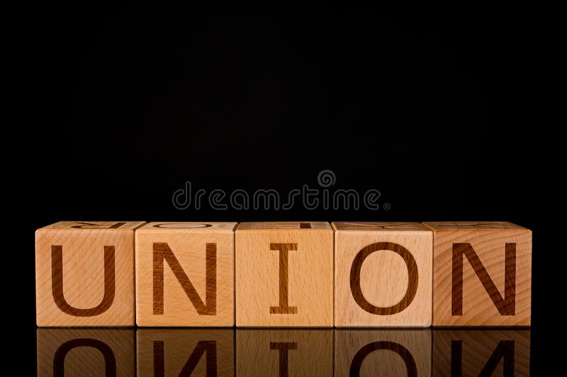 """Teamwork concept, Wood cube block with word """"UNION"""". royalty free stock images"""
