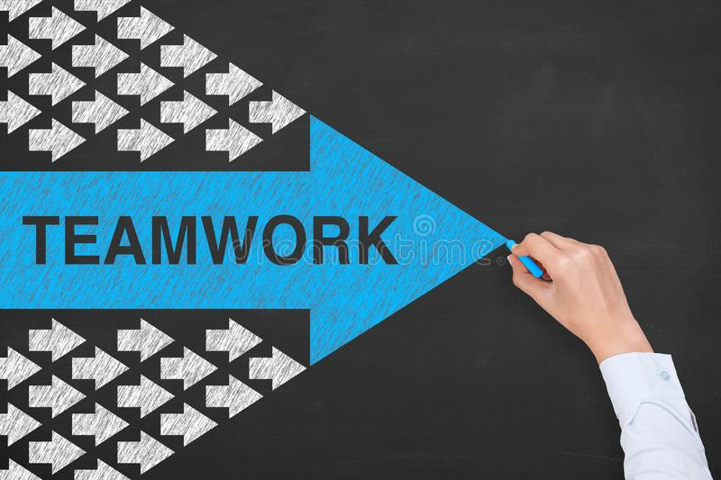 Teamwork Concepts with Arrow Symbol on Chalkboard Background royalty free stock photos