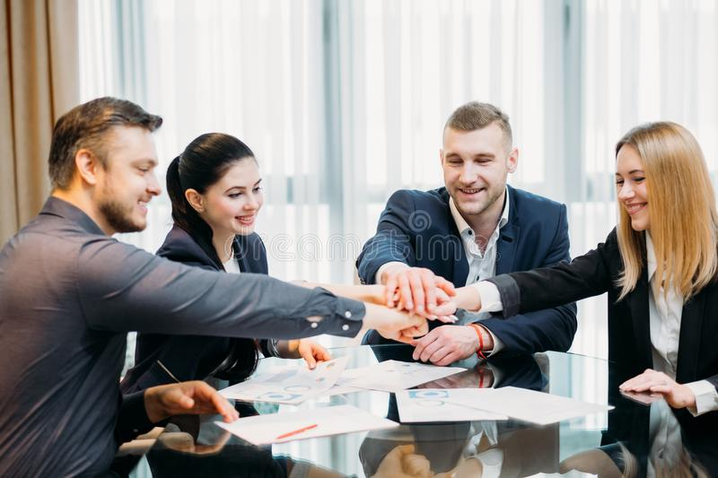 Teamwork unity business people hands together stock photography