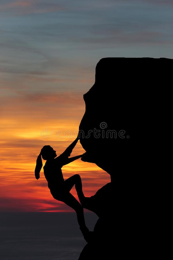 Teamwork couple hiking help each other trust assistance silhouette in mountains, sunset. Teamwork of man and woman hiker helping e. Ach other on top of mountain royalty free stock photography