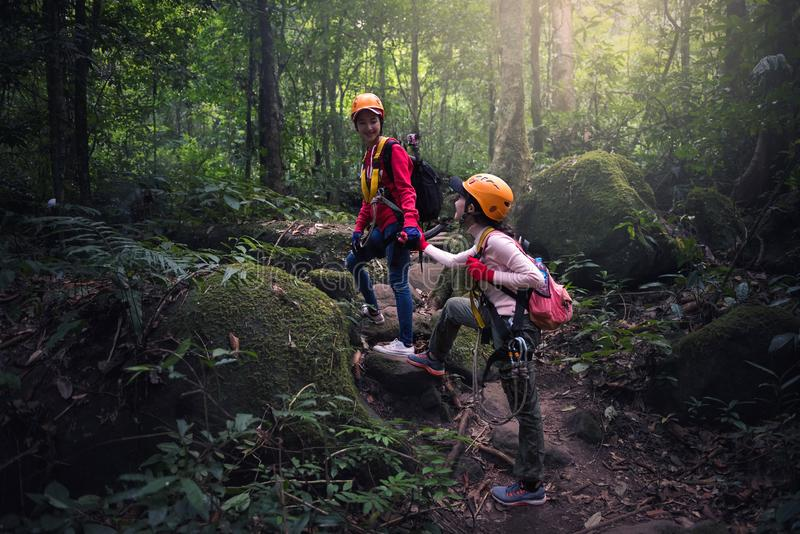 Teamwork couple hiking. Help each other trust assistance stock image