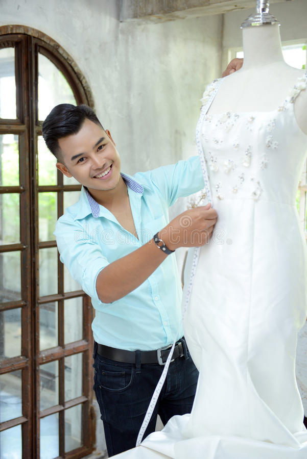 Teamwork designer concept : Fashion designer working near mannequin in office royalty free stock image