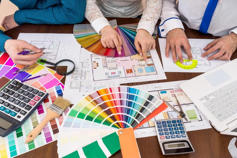 Teamwork of designers choosing colors for rooms. In house stock photos