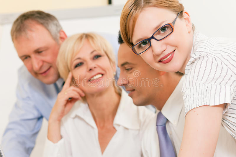 Teamwork - Discussion In The Office Royalty Free Stock Photo
