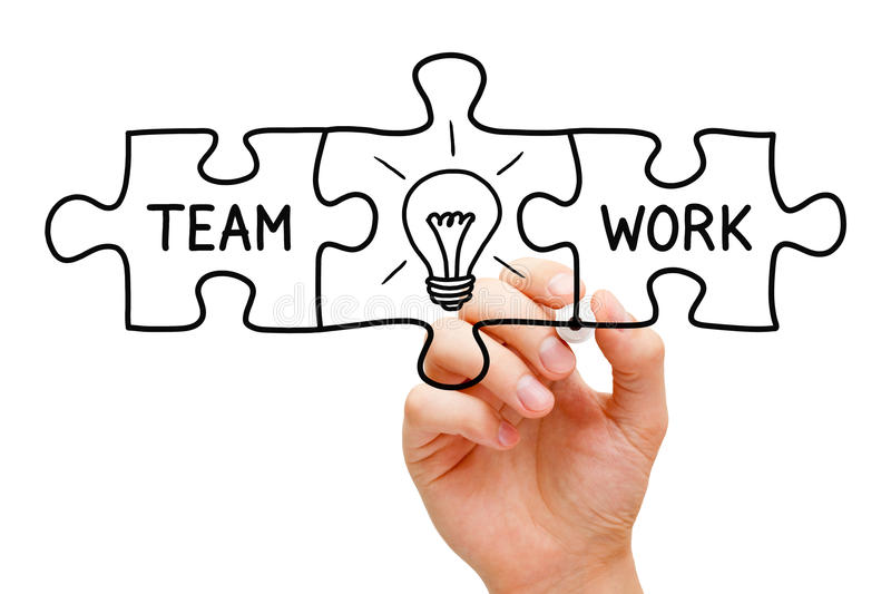 Teamwork Great Idea Puzzle Concept. Hand sketching Teamwork Great Idea Puzzle Concept with black marker on transparent wipe board royalty free stock photo