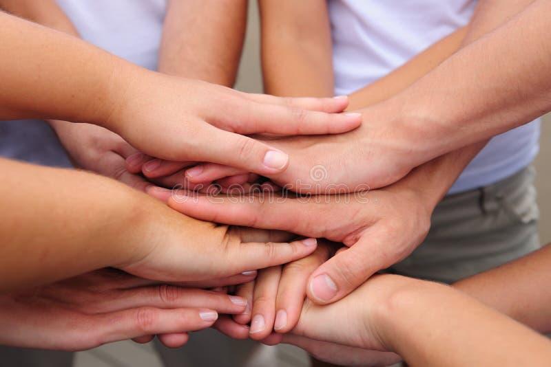 Teamwork hands together stock photo