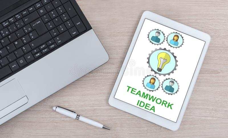 Teamwork idea concept on a digital tablet. Teamwork idea concept shown on a digital tablet royalty free stock photography