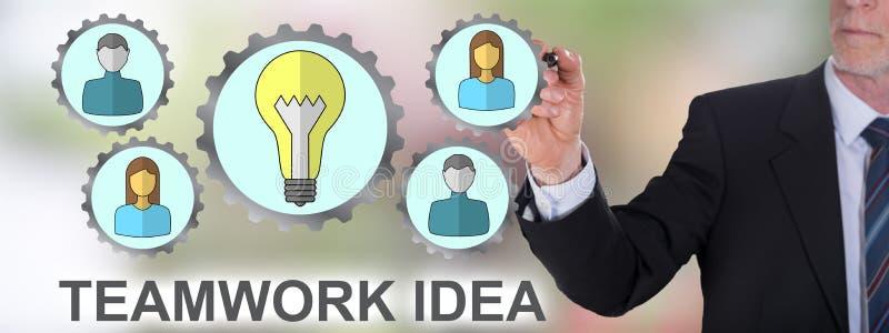 Teamwork idea concept drawn by a businessman. Businessman drawing a teamwork idea concept stock photos