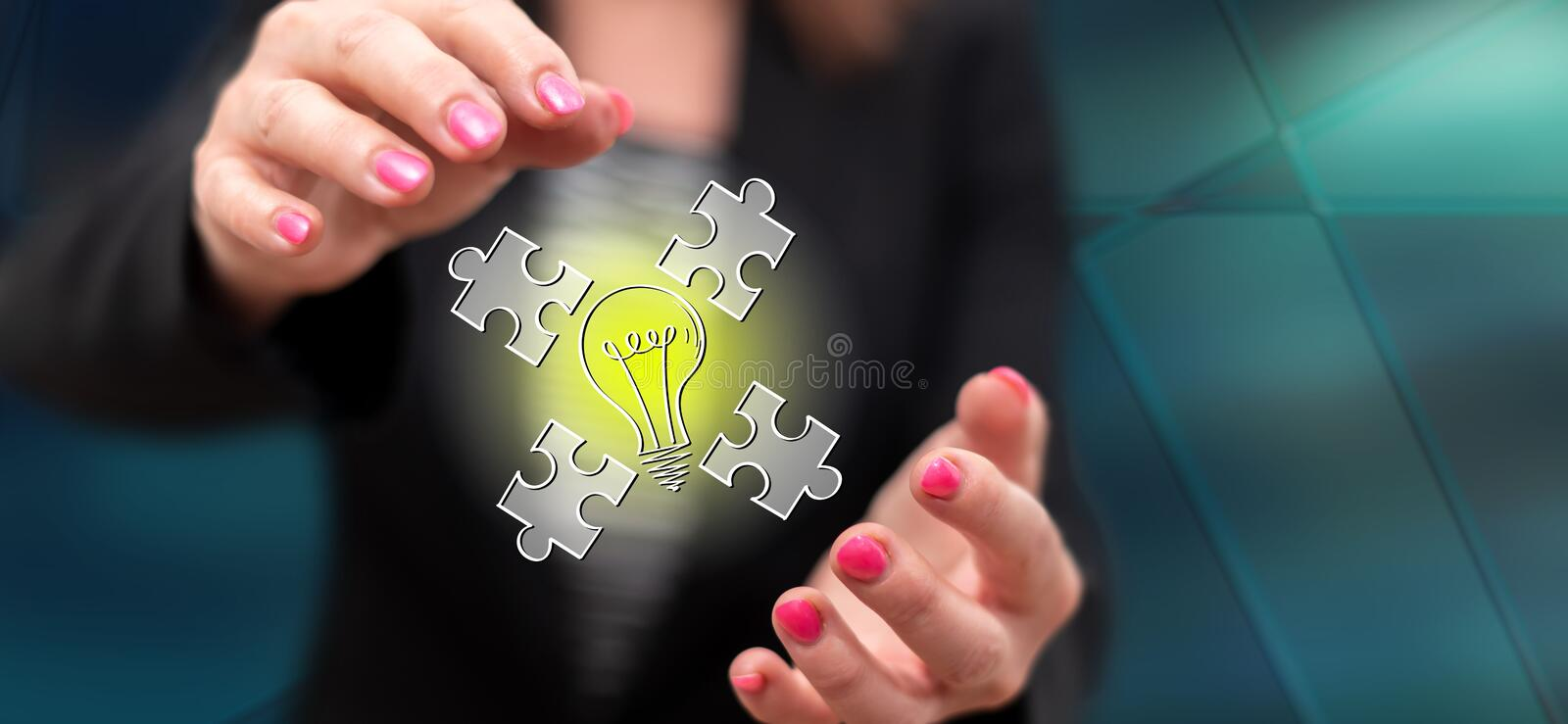Concept of teamwork idea. Teamwork idea concept between hands of a woman in background royalty free stock photos