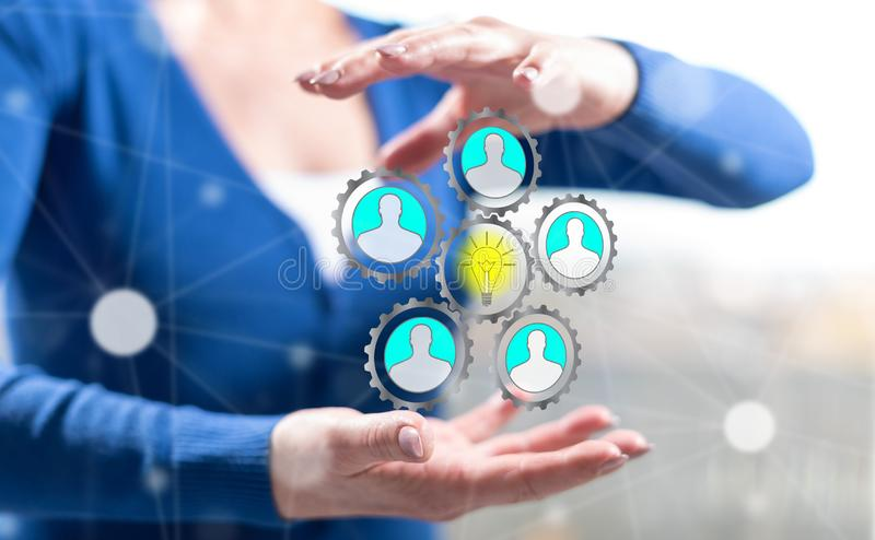 Concept of teamwork idea. Teamwork idea concept between hands of a woman in background royalty free stock images