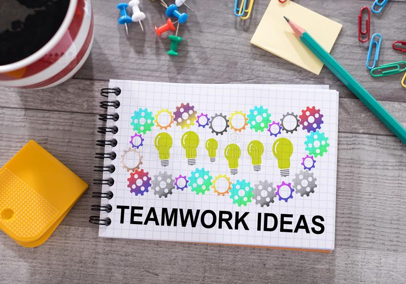 Teamwork idea concept on a notepad. Teamwork idea concept drawn on a notepad placed on a desk royalty free stock images