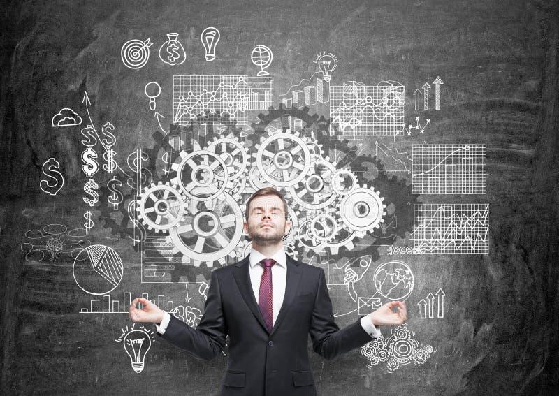 Teamwork-Konzept mit meditierendem Geschäftsmann lizenzfreies stockfoto