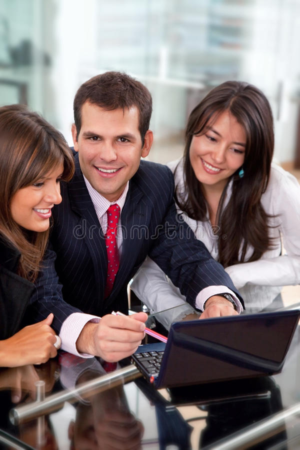 Download Teamwork with a laptop stock image. Image of businessteam - 12423579