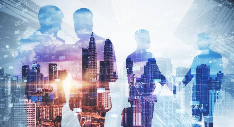 Teamwork and meeting concept. Businessmen silhouettes working together on blurry Kuala Lumpur city background with daylight. Teamwork and meeting concept royalty free stock photo