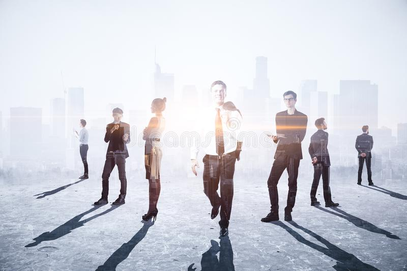 Teamwork, meeting and future concept. Businesspeople crowd silhouettes on light city office background. Double exposure stock images