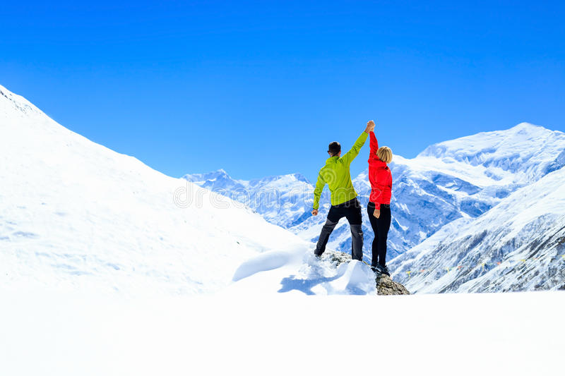 Teamwork motivation, success in winter mountains royalty free stock photo