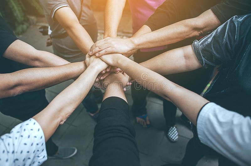 Teamwork With our arms and hands Collaboration in the work. Teamwork With our arms and hands Collaboration in the work Collaboration in the work royalty free stock photography