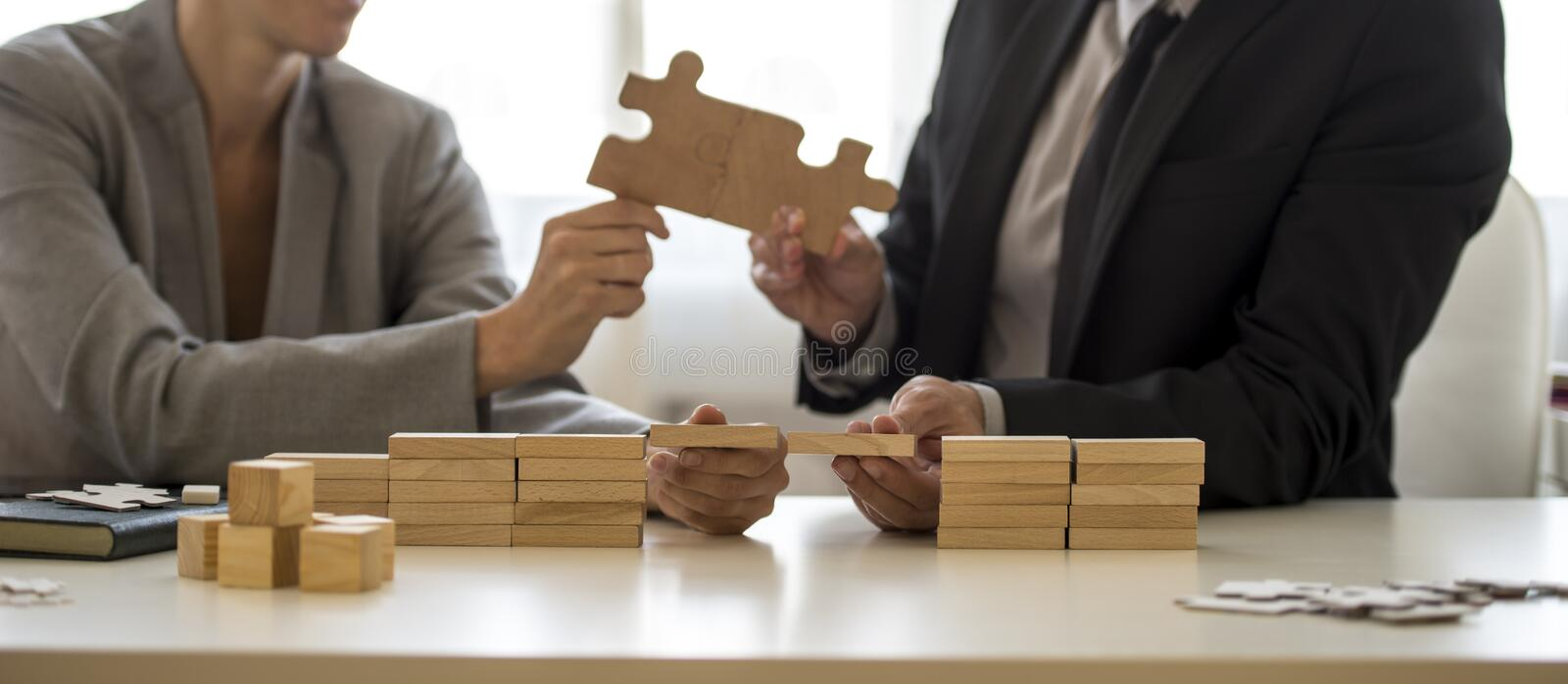 Teamwork or partnership concept with a businessman and businesswoman royalty free stock images
