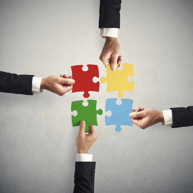 Teamwork and partnership concept. With puzzle royalty free stock image