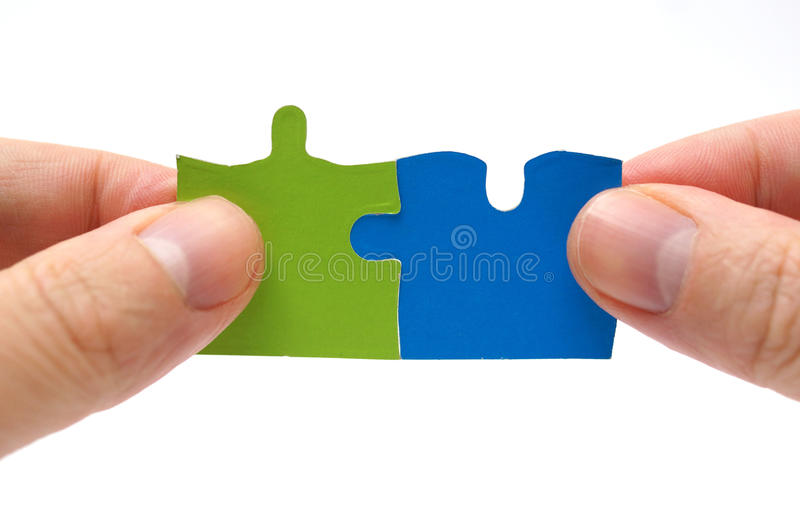 Teamwork and partnership concept with puzzle royalty free stock photography