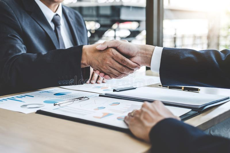 Teamwork partnership meeting concept, Two confident Business shaking hands after discussing good deal of trading contract and new. Projects for both companies stock photography