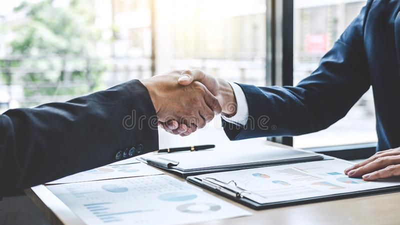 Teamwork partnership meeting concept, Two confident Business shaking hands after discussing good deal of trading contract and new. Projects for both companies stock images