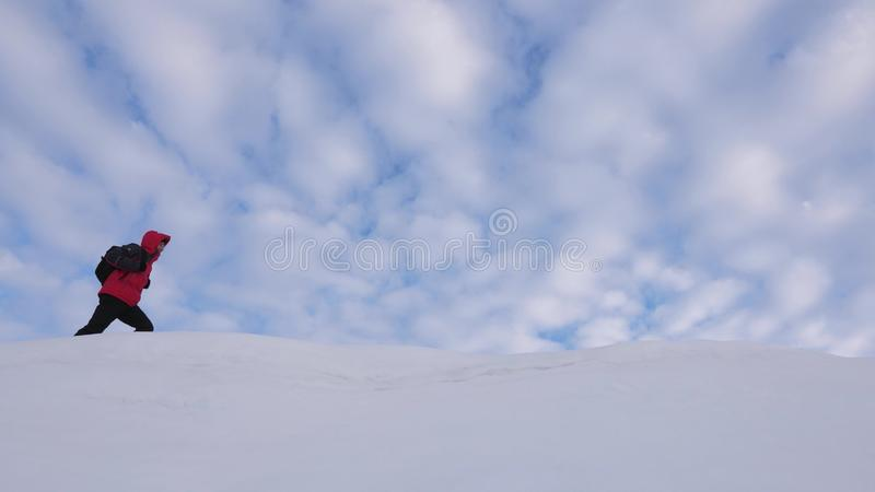 Teamwork people in difficult conditions. climbers team in winter go to top of the mountain. Travelers follow one another royalty free stock photos