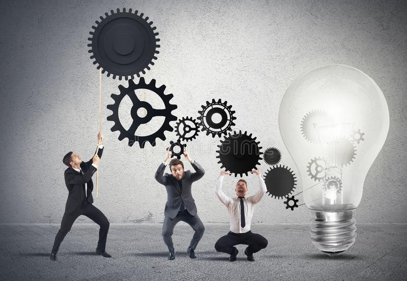 Teamwork powering an idea. With gear system stock image