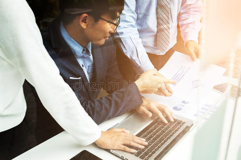 Teamwork process, Business hands pointing at laptop and document stock image