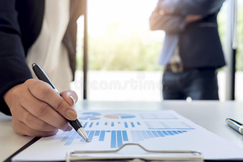 Teamwork process, Business team two managers colleagues discussing and analysis new plan financial graph data and marketing royalty free stock image